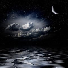Night sky stars reflecting in sea