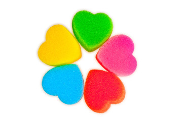 Flower of colored hearts on white