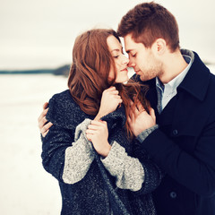 outdoor fashion portrait of young sensual couple