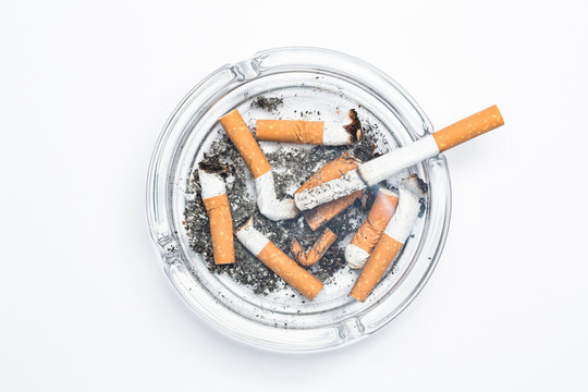 Overhead of burning cigarette in ashtray