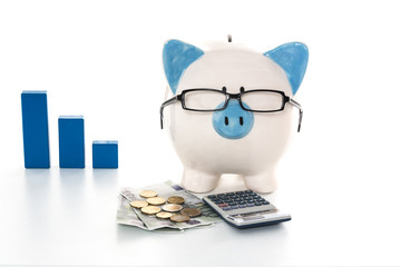 Piggy bank wearing glasses with calculator and cash and blue gra