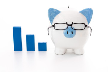 Piggy bank wearing glasses with blue graph model