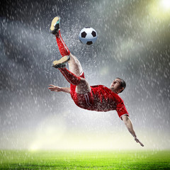 Spoed Fotobehang Voetbal football player striking the ball