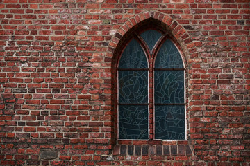 Gothic brick wall with a window,a stained glass window
