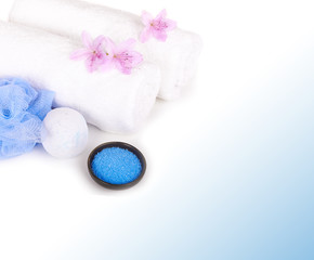 white towels, salt, bath sponge and aromatic flowers