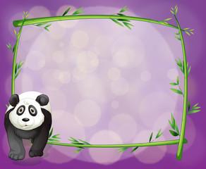 A big panda beside an empty bamboo frame