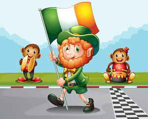 A man walking at the road holding the flag of Ireland