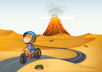 A boy riding a bike in the desert