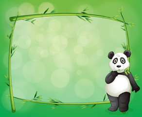 A panda beside a frame made of bamboo