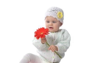 baby girl  with red flower