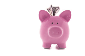 Dollar note stuck in piggy bank