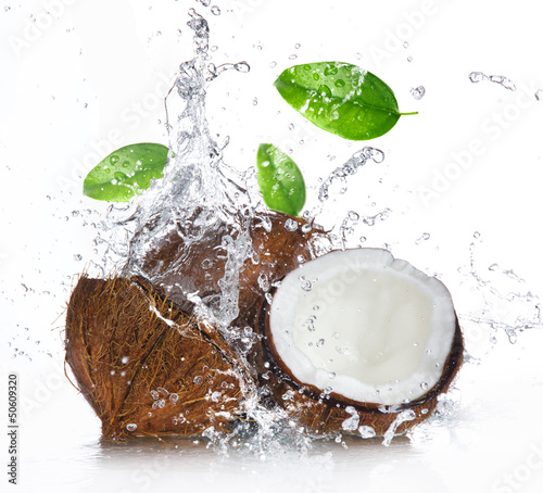 Wall mural cracked coconut with splashing water