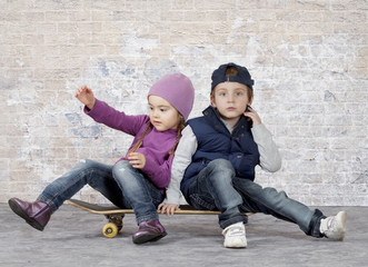 Kids on a skateboard