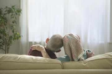 Senior couple sitting together on sofa