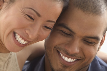 Close up of couple laughing