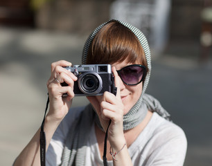 Woman using photo camera