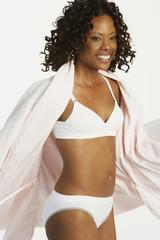 African woman wearing underwear and bathrobe