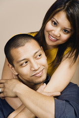 Portrait of Asian couple hugging