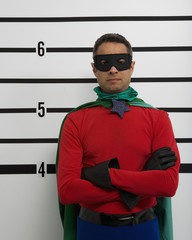 Male superhero standing in police line up