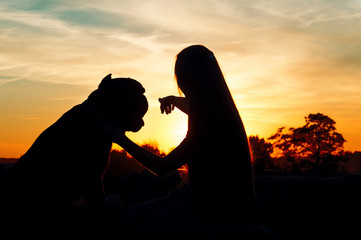 the girl with the dog at sunset