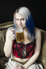 Beautiful Young Woman with Blue Hair Drinking Beer