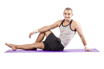 Man doing exercises on white