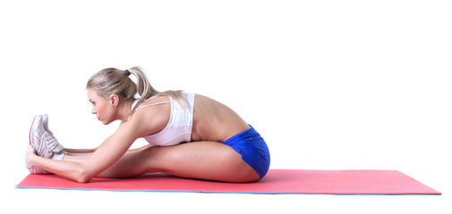 Attractive sporty girl doing exercises on mat