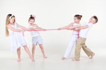 Four cute little boys and girls overtighten pink rope
