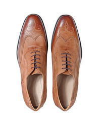 male brown leather shoes isolated on a white