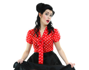 woman pinup makeup hairstyle posing in studio