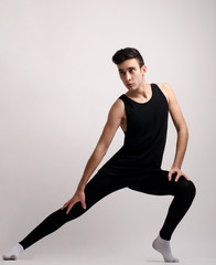 Cool looking ballet dancing of a young handsome man.