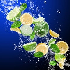 Limes with lemons in water splash