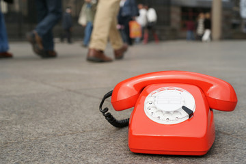 Red vintage telephone in the city