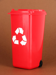 Recycling bin on brown background