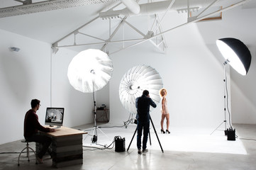 Photographer working with a Cute Model in a Professional Studio Wall mural