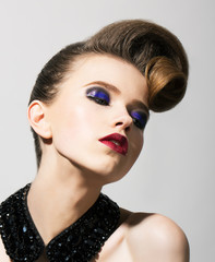 Imagination. Woman with Blue Holiday Makeup and Hairstyle