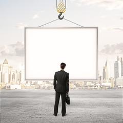 men looking at billboard