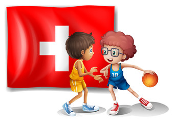 The flag of Switzerland at the back of the two athletes