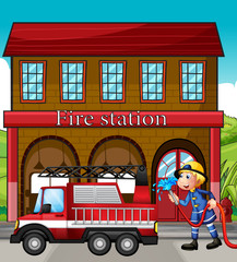 A fireman and a fire truck in front of the fire station