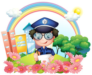 A policeman writing near the flowers