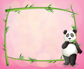 A panda and the green bamboo frame