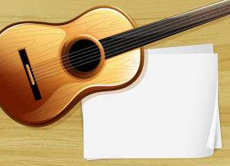 A guitar with an empty bondpaper