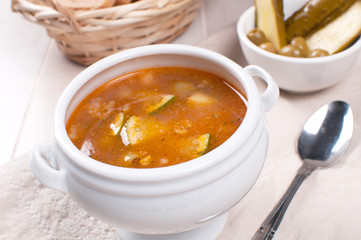 Tomato soup with olives and pickles