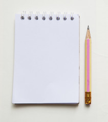 pencil and white paper note book