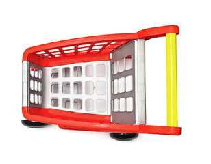 The empty red cart for purchases on the white