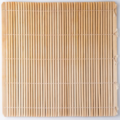 Bamboo mat for sushi. Straw colored background