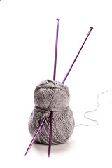 Grey wool and needles