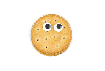Funny cookie decorated with eyes isolated on a white background