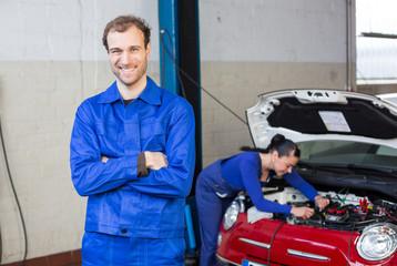 Car mechanic in garage or workshop