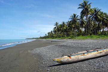 Canoe at ocean coast